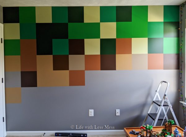 This Minecraft Wall was created with removable vinyl squares in different colors and cost about $60.
