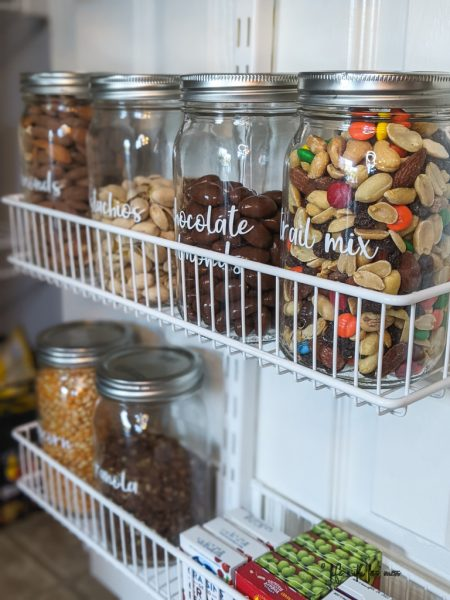 Use a pantry door to save space. Decant food into jars.