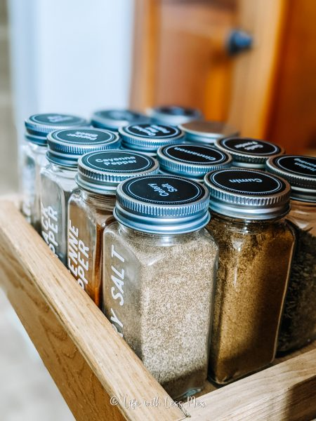 Previously, spices were organized in a pull out cabinet, where they shifted and I couldn't see the spice labels.