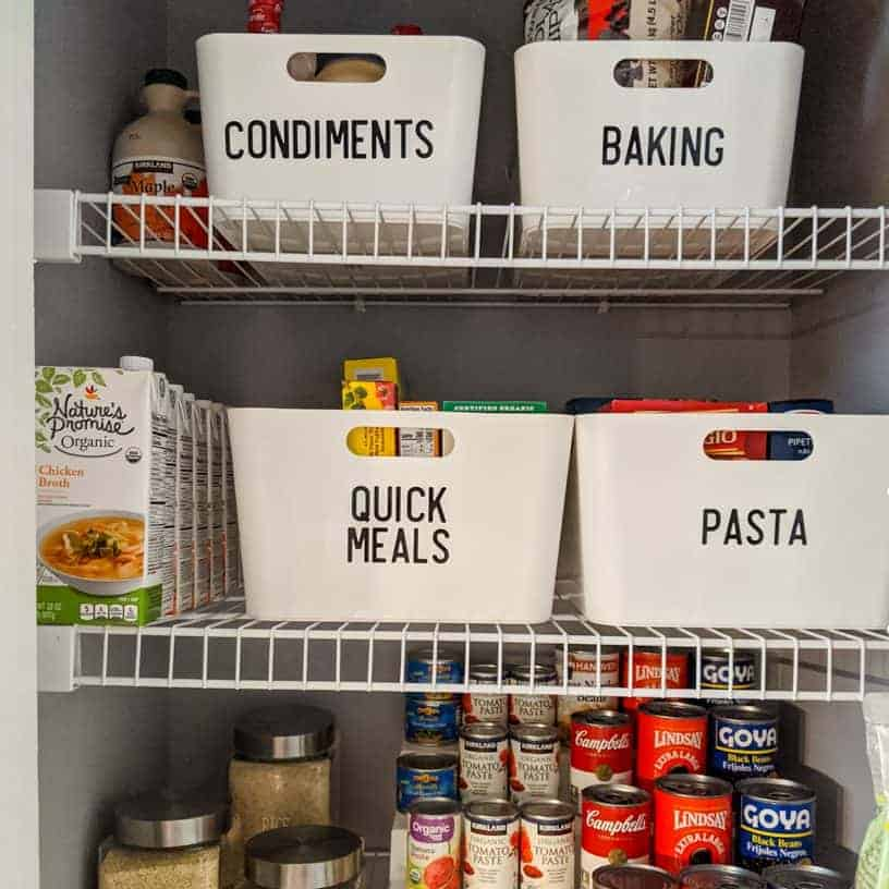 Using bins in a small pantry helps you access items on the back of the shelf and sets limits so you don't overbuy.