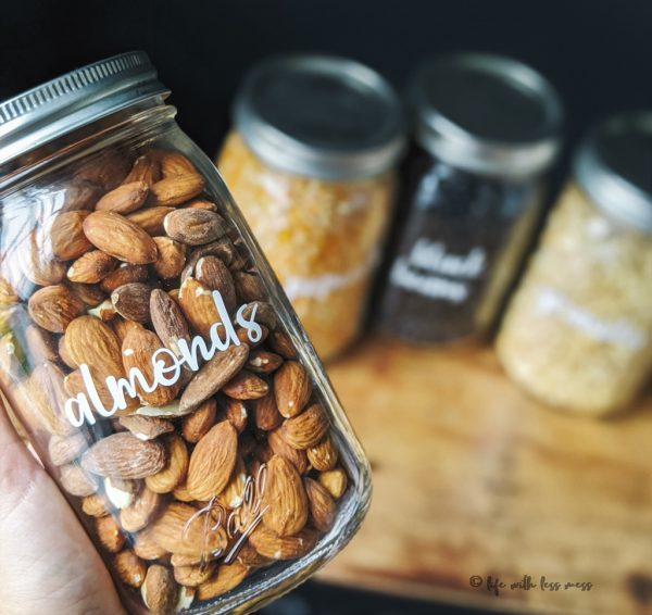 Which is nicer to look at, this glass jar of almonds or a loud plastic bag?