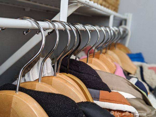 Investing in matching wooden hangers is a great splurge for your coat closet organization project.