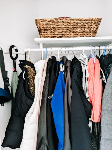 Hooks are perfect for umbrellas and leashes when you're working on your coat closet organization project.