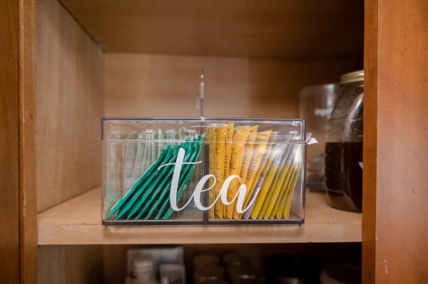 One way to organize tea is in an acrylic caddy.