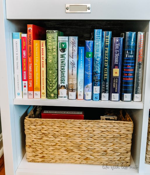 Color-blocked books and a basket made of natural fibers reduces visual clutter.