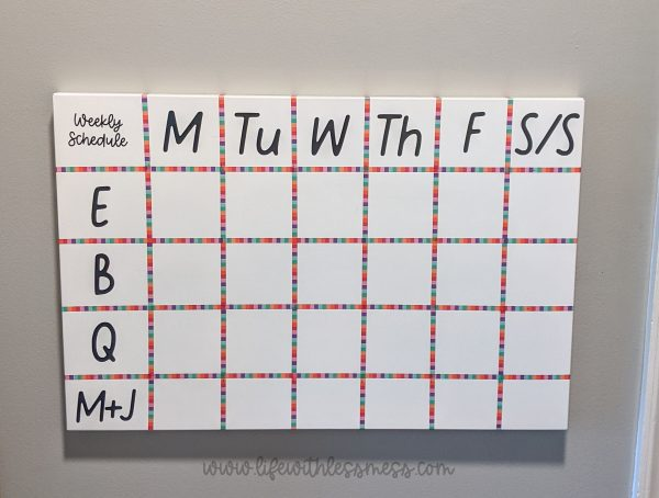 Hang your family schedule in a place that's easy to see on your way out the door!