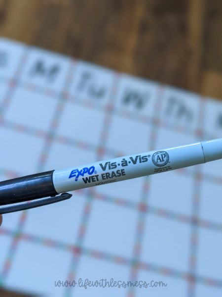Wet or Dry erase marker will work -- but wet erase markers will last longer!